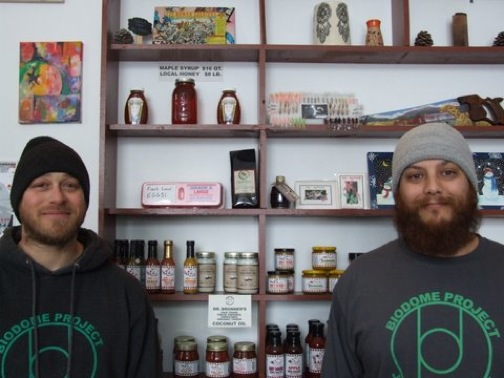 Ryan Peterson, pictured at left, and Clint Peyton proudly display a small portion of the items BioDome Project sells for area artisans and producers, along with their own plants, organic supplies and growing systems.