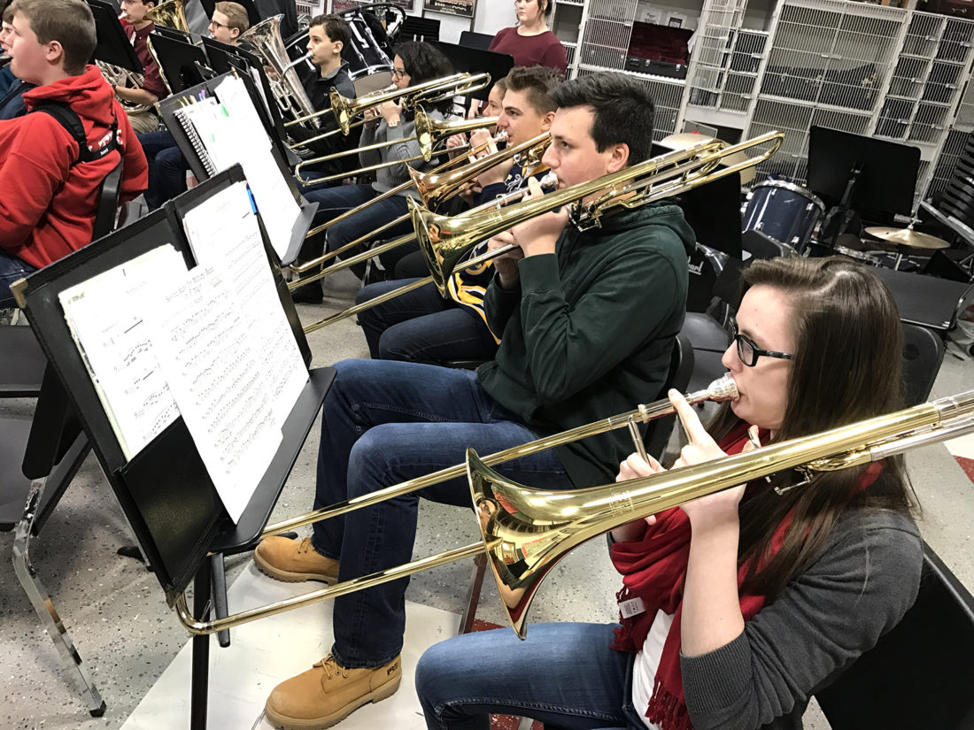 Concert Band trombone players, Mackenzie Abbey, Ben Russo, Christian Dolce, Christina McMillan and Sarah Pillittieri warm-up during a recent rehearsal.