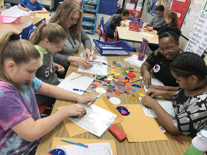 """Washington Middle School recently held a """"Bring Your Parents to School"""" Day sponsored by the school's Family & Community Engagement Committee. Pictured are: Gabriella Zampogna, Alyson Canfield, Patti Denzel, Melissa Brown and Mikayla Brown who were working on an equivalent fractions activity in Deb Rein's fifth grade class."""