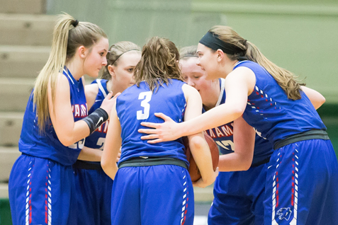 The Lady Panthers huddle during the game at the Edward F. McDonough Sports Complex.