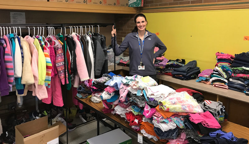 "Ring Elementary School physical education teacher, Julie Irons, shows off the school's ""Clothes Closet."""
