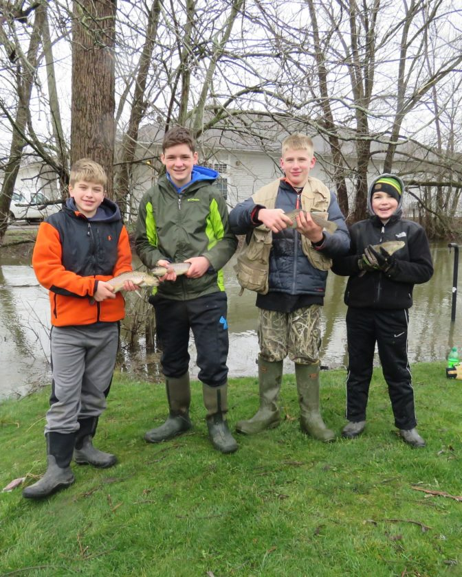 Four young friends display just a portion of the 12-15 inch brown trout they caught on opening day of trout season Saturday. From left are Toby Gifford, 12, of Frewsburg; Carter McKotch, 14, of Lakewood; Zachary Gifford, 13, of Frewsburg; and Austin McKotch. 10,  of Lakewood. P-J photo by Deb Everts