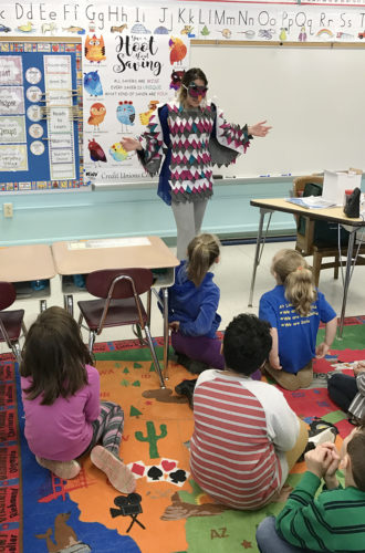 """Charlene Austin, Southern Chautauqua Federal Credit Union's Director of Financial Education, talked with Lincoln Elementary School second graders about savings with their """"Give a Hoot About Savings"""" program during the Kids' Credit Union."""