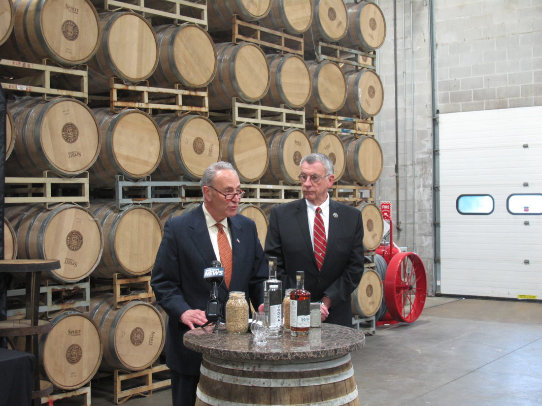 Sen. Schumer and Horrigan talk to the press at Southern Tier Distilling Company in Lakewood.  P-J photo by A.J. Rao