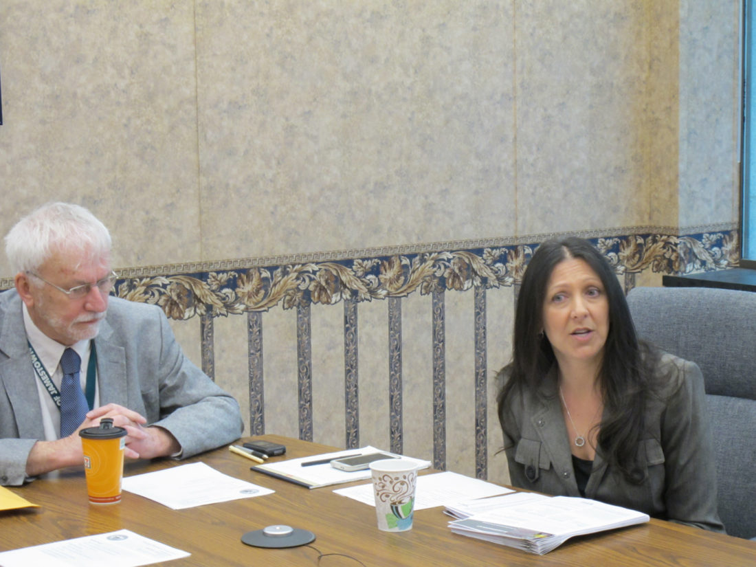 From left, Gregory Rabb, Jamestown City Council president and co-chairman for the city Strategic Planning and Partnerships Commission; and Terri Cook, author and transgender advocate, who was a guest speaker during the commission's monthly meeting Thursday. P-J photo by Dennis Phillip