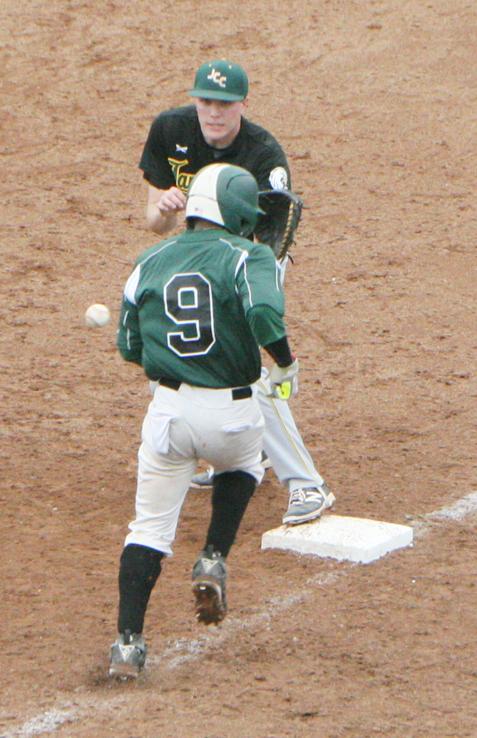 Jamestown CC first baseman Matt Hair, top, attempts to make a putout as Tompkins Cortland's Kavon Ruffin nears the bag. P-Jphotos by Scott Kindberg