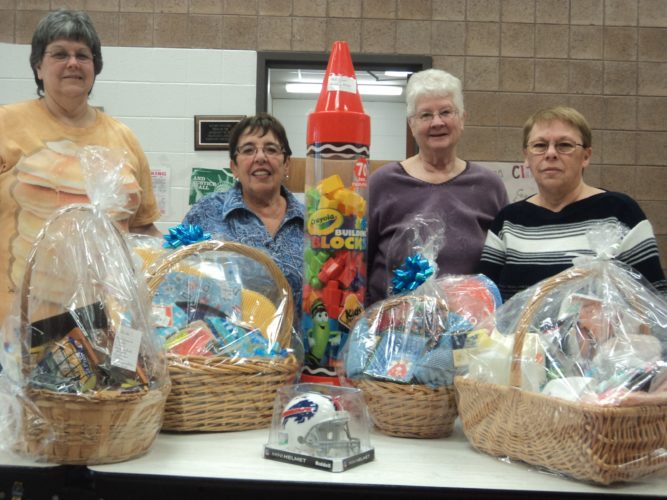 Pictured with some of the gifts to be won at the Winifred Crawford Dibert Boys and Girls Girls Club pancake breakfast are event coordinators Veronica Mistretta (far left)  and Barb Tramonte (far right) along with adult members Diane Couchenour and Carol Fitzpatrick.