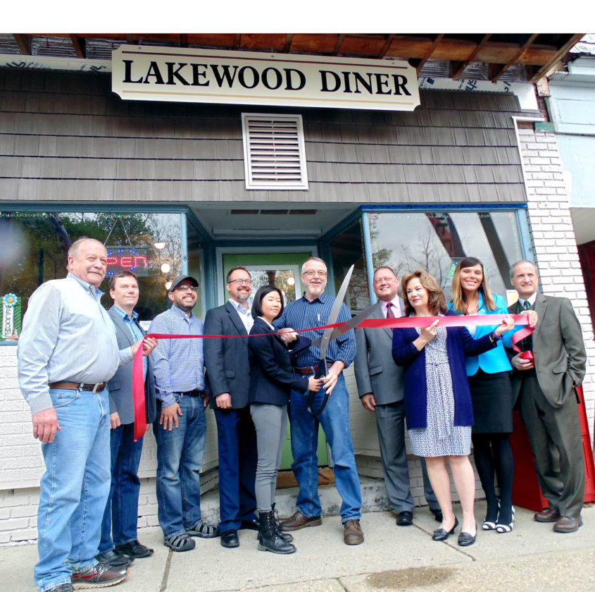 On Tuesday, Lakewood Diner held a ribbon-cutting ceremony with the Chautauqua County Chamber of Commerce and village officials. Located at 48 Chautauqua Ave., Lakewood Diner opened earlier in the year. Owners Morgan Hatrick and Sara Pang, pictured in the middle, get ready to cut the ribbon.  P-J photo by Jimmy McCarthy