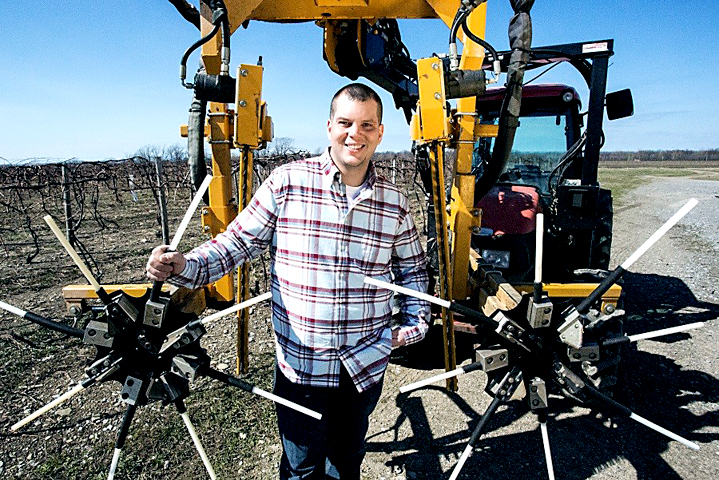 Dan Sprague Jr. with a mechanical pruner at Cornell Lake Erie Research and Extension Laboratory. Submitted photo