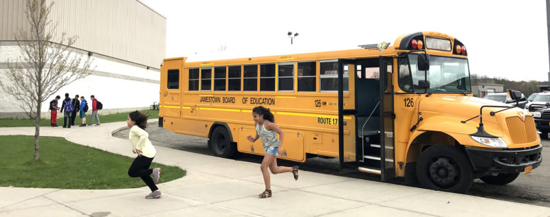 Jefferson Middle School students exit the bus to go to school in the morning.