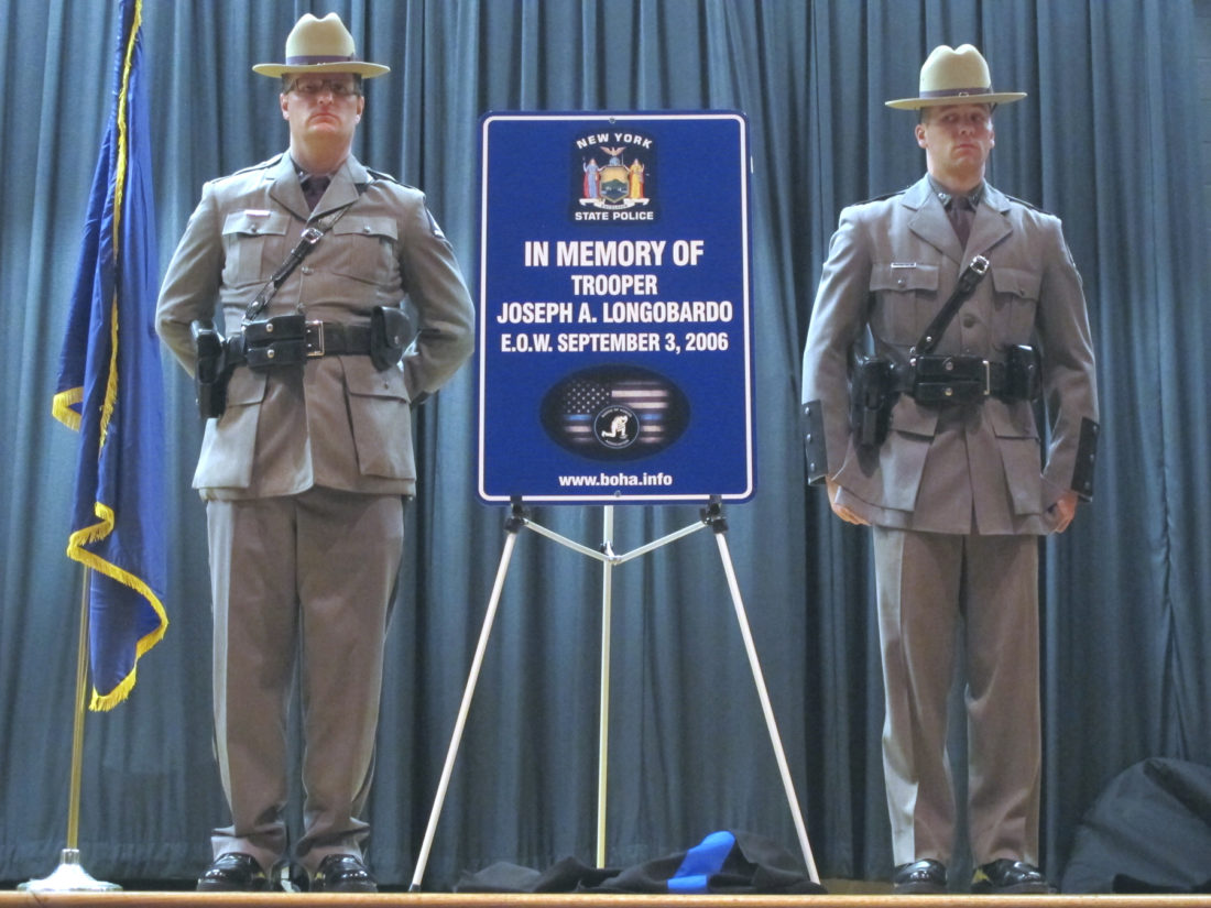 The Badge of Honor Association held a sign dedication ceremony at Persell Middle School on Saturday morning honoring four fallen officers. BOHA supports law enforcement agencies across the 25 counties of western and central New York. P-J photo by Remington Whitcomb