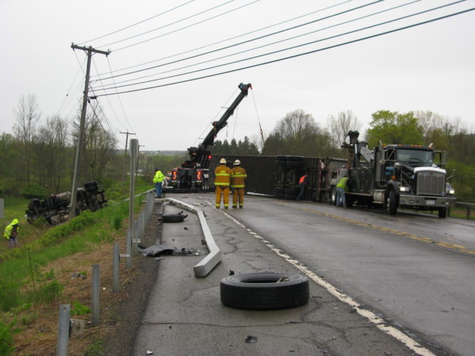 A semi tractor-trailer overturned Thursday morning in the town of Gerry following a head-on crash on Route 60. P-J photo by Eric Tichy