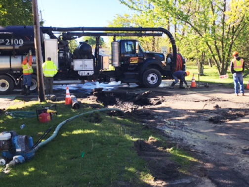 Brocton Department of Public Works employees tend to a major water line break Monday morning.