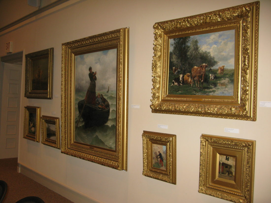 A few of the oil paintings hanging in the Fireplace Room at the James Prendergast Library, located at 509 Cherry St. The library board has decided to once again sell some of the artwork, which is valued at more than $1 million.<br/>P-J photo by Gavin Paterniti