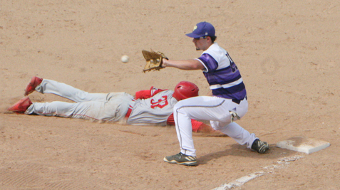 Winston-Salem State's Randy Norris (32) dives safely back to first base ahead of the pickoff attempt that is being received by West Chester first baseman Jared Melone during the the second game of the NCAA Division II Atlantic Regional at Diethrick Park on Thursday. P-J photos by Scott Kindberg