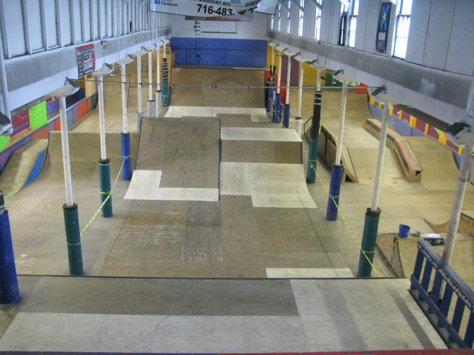 """The """"Soar Up"""" skate park at Community Helping Hands, located inside Jamestown's Gateway Family Center at 31 Water St., recently installed 59 new plywood panels to replace portions of the skate park that had been damaged following a March 8 wind storm that blew off the roof above the park. P-J photo by Gavin Paterniti"""