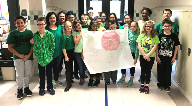 Jefferson Middle School fifth-graders in Gina Hess' class are pictured with a banner they made as part of Mental Health Awareness Month.