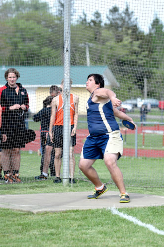 Falconer/Cassadaga Valley's Nick Bishop throws the discus in Fredonia on Monday. Photo by Roger Coda