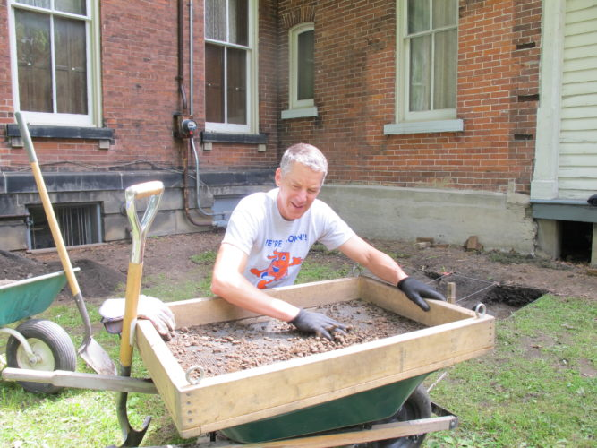 John Gustafson of Jamestown sifts through dirt looking for artifacts while participating in the archaeological dig at the Fenton History Center. This is the sixth year for the archaeological project at the Fenton History Center.  P-J photo by Dennis Phillips