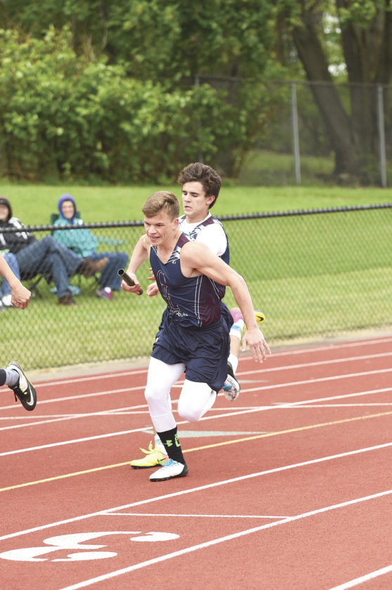Chautauqua Lake's J.C. McCroskey hands the baton to teammate Evan Blakeslee during the 400-meter relay at the Chautauqua-Cattaraugus Athletic Association Track & Field Championships on Friday in Dunkirk. Photo by Roger Coda