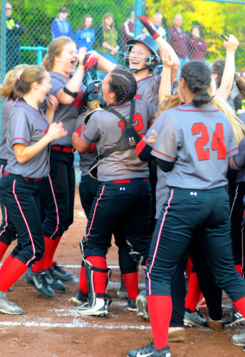 Maple Grove's Caleigh Swanson is greeted by her teammates after her two-run home run in the fourth inning of Saturday's Section VIClass C2 championship game against Portville. P-J photo by Matt Spielman