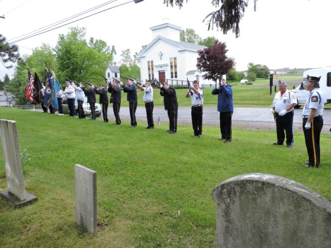 Members of the Cassadaga American Legion Post 1280 Honor Guard gave tribute to veterans at 10 area cemeteries Monday. Shown is the group in formation under the leadership of James Hayward at the Charlotte Center Cemetery.