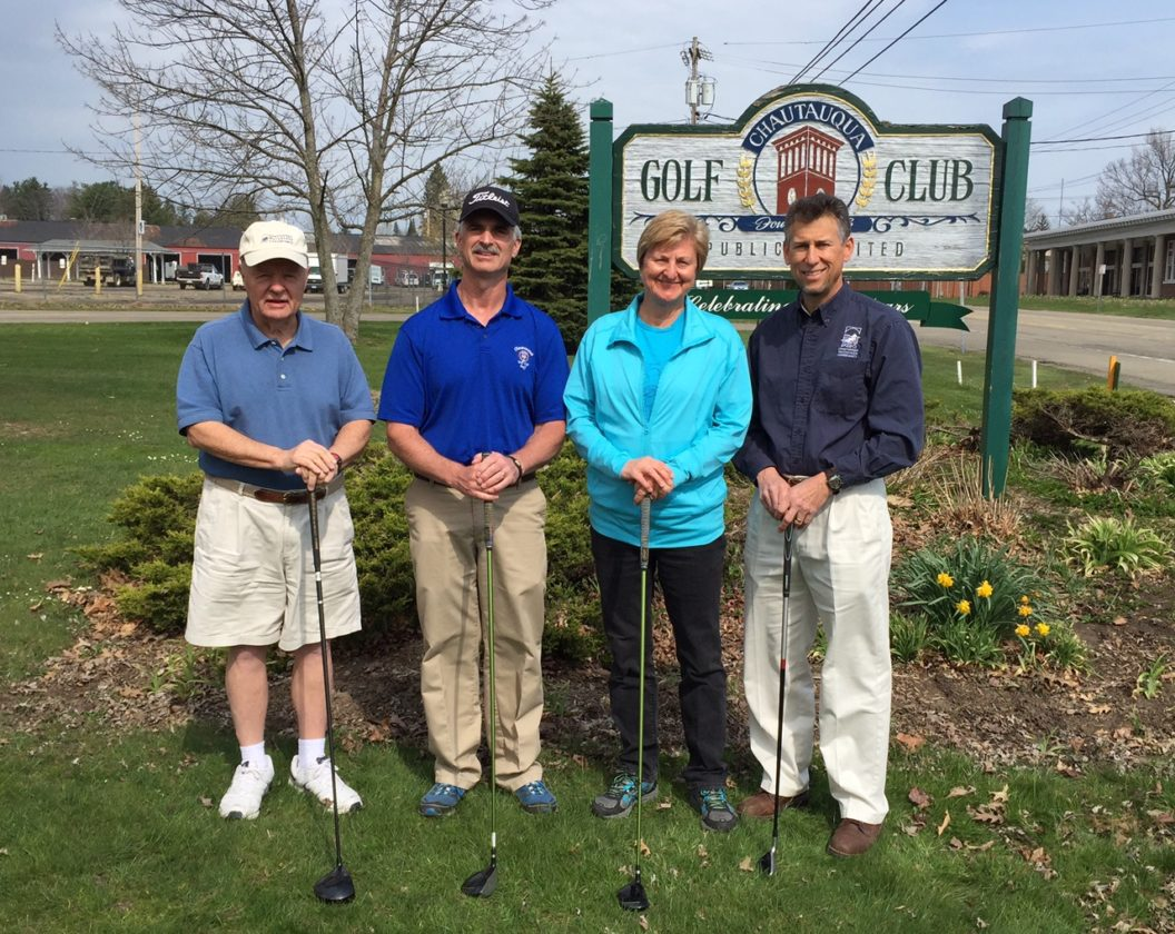 The Chautauqua Watershed Conservancy will be the beneficiary of the Chautauqua Golf Club's 31st annual PGA Pro-Am Golf Tournament. Pictured from left are event chairman Bill Locke, PGA professional Troy Moss, Dr. Jeanne Wiebenga, Chautauqua Watershed Conservancy board member, and John Jablonski III, Chautauqua Watershed Conservancy executive director.   Photo by Don Kimmel