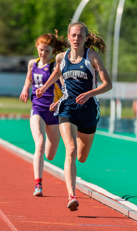 Bailey Gostomski runs to a victory in the Division 2 3,000 meters. P-J photos by Tim Frank