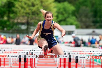 Falconer/Cassadaga Valley's Brooke Weinman runs the 100-meter hurdles as part of the Division 2 pentathlon.  P-J photos by Tim Frank