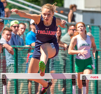 Lauren Swan clears a hurdle en route to a state-qualifying second-place finish in the Division 2 400-meter hurdles. P-J photos by Tim Frank