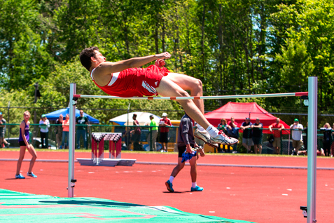 Maple Grove's Mitch Padilla clears the bar during the Division 2 high jump. P-J photos by Tim Frank