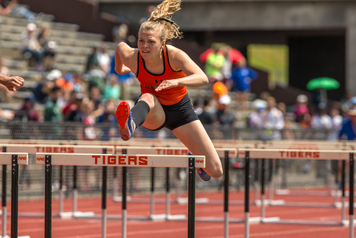 Fredonia's Lydia Lanski leaps a gate en route to a third-place showing in the Division II 100-meter hurdles. P-J photo by Tim Frank
