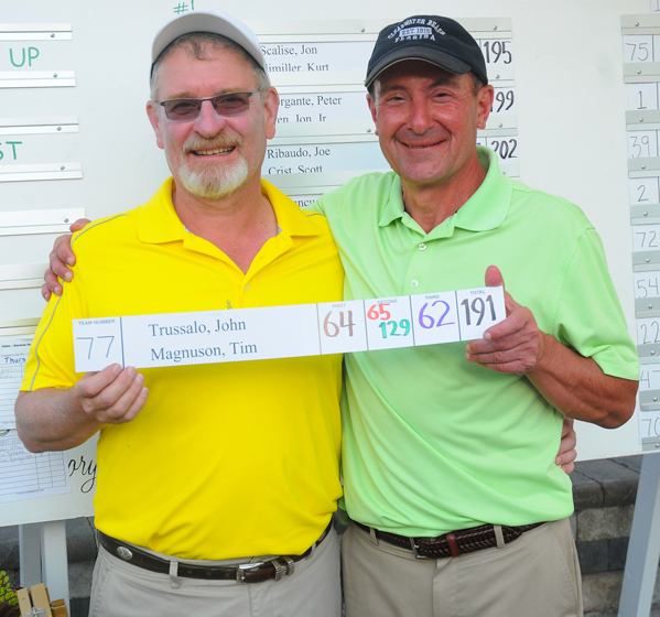 Tim Magnuson, left, and John Trussalo are pictured after winning the 47th annual Italian-American Charity Golf Tournament on Saturday at Holiday Valley in Ellicottville. P-J photo by Scott Kindberg