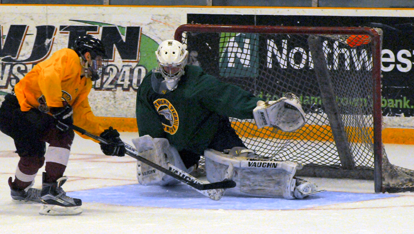 Forward Tristan Mock skates in alone on goaltender Ryan Pascarella during the fourth scrimmage of the Southern Tier Xpress' pre-draft camp Sunday afternoon at Northwest Arena. P-J photo by Matt Spielman