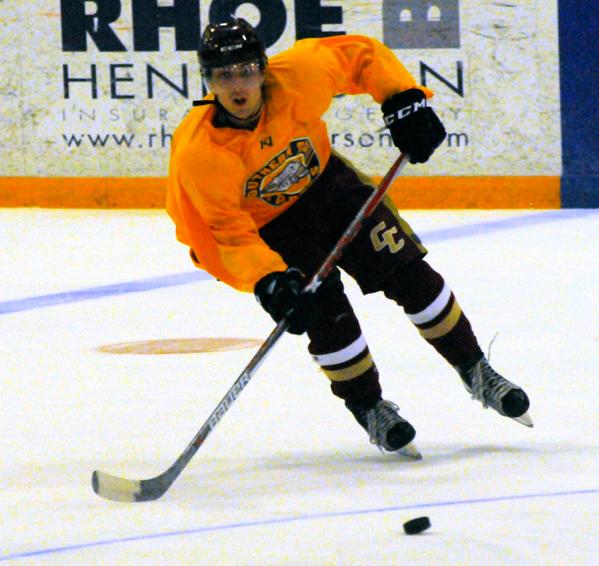 Mackenzie Restle skates to the puck during Sunday's second scrimmage at Northwest Arena. P-J photo by Matt Spielman