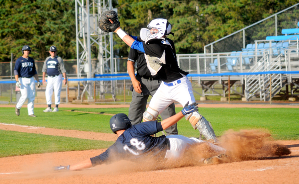 Frewsburg's Caleb Caldwell slides safely into home ahead of a tag from Westfield catcher Max Bates during Wednesday's Chautauqua and Cattaraugus Counties Senior All-Star Classic at Diethrick Park. P-J photos by Matt Spielman