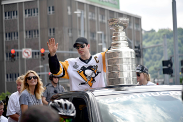 Jamestown native Paul Kosko attended the Pittsburgh Penguins' Stanley Cup parade Wednesday. Pictured, above left, is Sidney Crosby riding in a truck with the Stanley Cup.  Photos by Paul Kosko