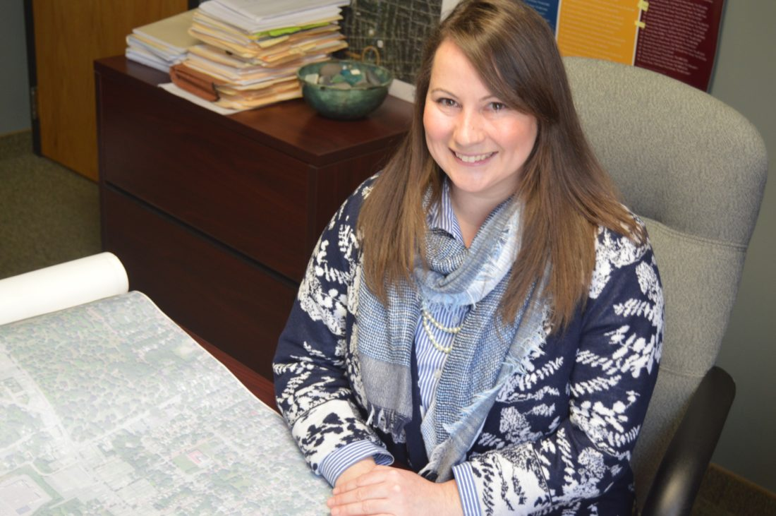 Sarah Gilbert, Jamestown Renaissance Corporation grant writer, reviews a map of the City of Jamestown. Gilbert is a Jamestown High School graduate and Chautauqua Region Community Foundation scholarship recipient.