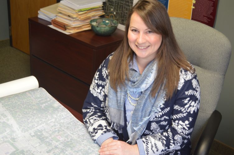 Sarah Gilbert, Jamestown Renaissance Corporation grant writer, reviews a map of the City of Jamestown. Gilbert is a Jamestown High School graduate and Chautauqua Region Community Foundation scholarship recipient.