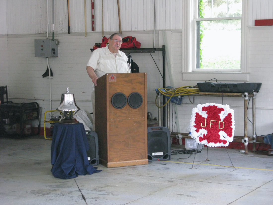 Leo Duliba, historian for the Jamestown Fire Department, speaks Sunday at the memorial service. Duliba read aloud some of the names of firefighters who have passed away. P-J photo by Eric Tichy