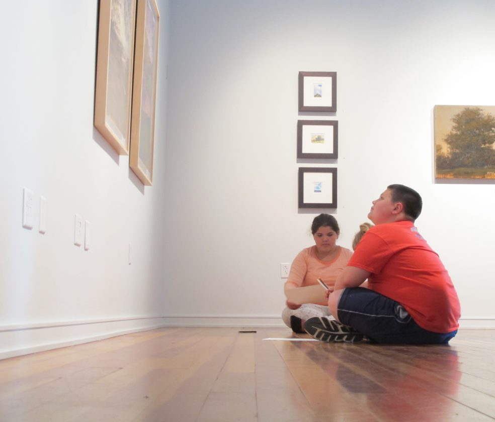 Students from Tom McFall's fifth-grade class sketch their favorite landscape portrait at the Strohl Art Center in the Chautauqua Institution. P-J photo by Remington Whitcomb