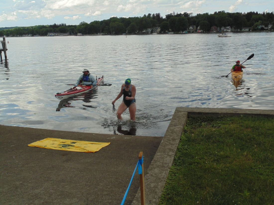 Great Lakes researcher and SUNY Fredonia professor Sherri Mason reaches the finish line of her 15.5-mile swim on Chautauqua Lake on Monday. Starting at Lakeside Park in Mayville, she finished at Lucille Ball Memorial Park in Celoron. The swim was timed at 10 hours and 37 minutes. P-J photo by Jimmy McCarthy