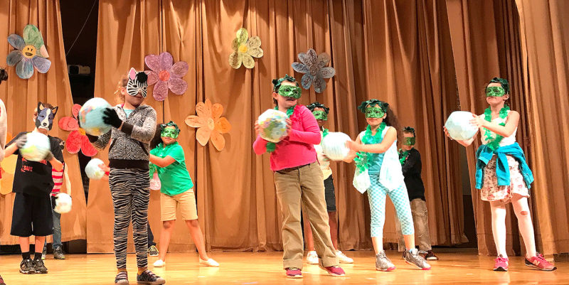 Ring Elementary School students are pictured performing a song about life cycles recently.