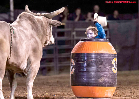"Rodeo clown Clint ""Wolfey"" Selvester goes ""nose to nose"" with a bull as part of his job to help protect the bull riders. Photo by Dustin J. Olson Photography"