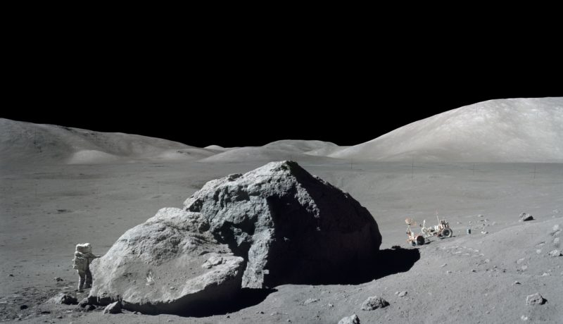 Scientist-astronaut Gene Cernan is shown standing next to a large split lunar boulder during the Apollo 17 mission. The Lunar Roving Vehicle is parked on the right side of the boulder. Take a look at the moon with binoculars or a small telescope this month – it's amazing what you can see.  Courtesy NASA, Eugene Cernan