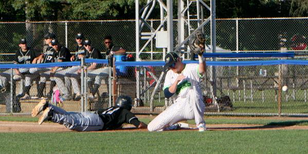 Jammers' first baseman Ben Brookover has a pickoff throw skip past him. P-J photos by Matt Spielman
