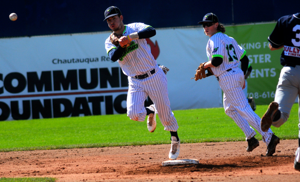 Jamestown shortstop Alex O'Donnell throws to first base for a double play during the third inning Sunday. P-J photo by Matt Spielman