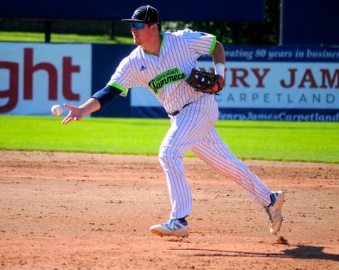 Jamestown's Ben Brookover flips late to first base during the fifth inning Sunday. P-J photo by Matt Spielman