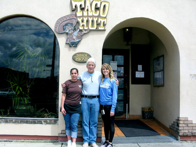 Taco Hut is celebrating its 45th anniversary since opening in 1972 at 203 E. Third St. in Jamestown. From left are Heidi Barlow, waitress and cook, Jim Mason, owner, and Alecia Spontaneo, cook, waitress, bartender and server. P-J photo by Gavin Paterniti