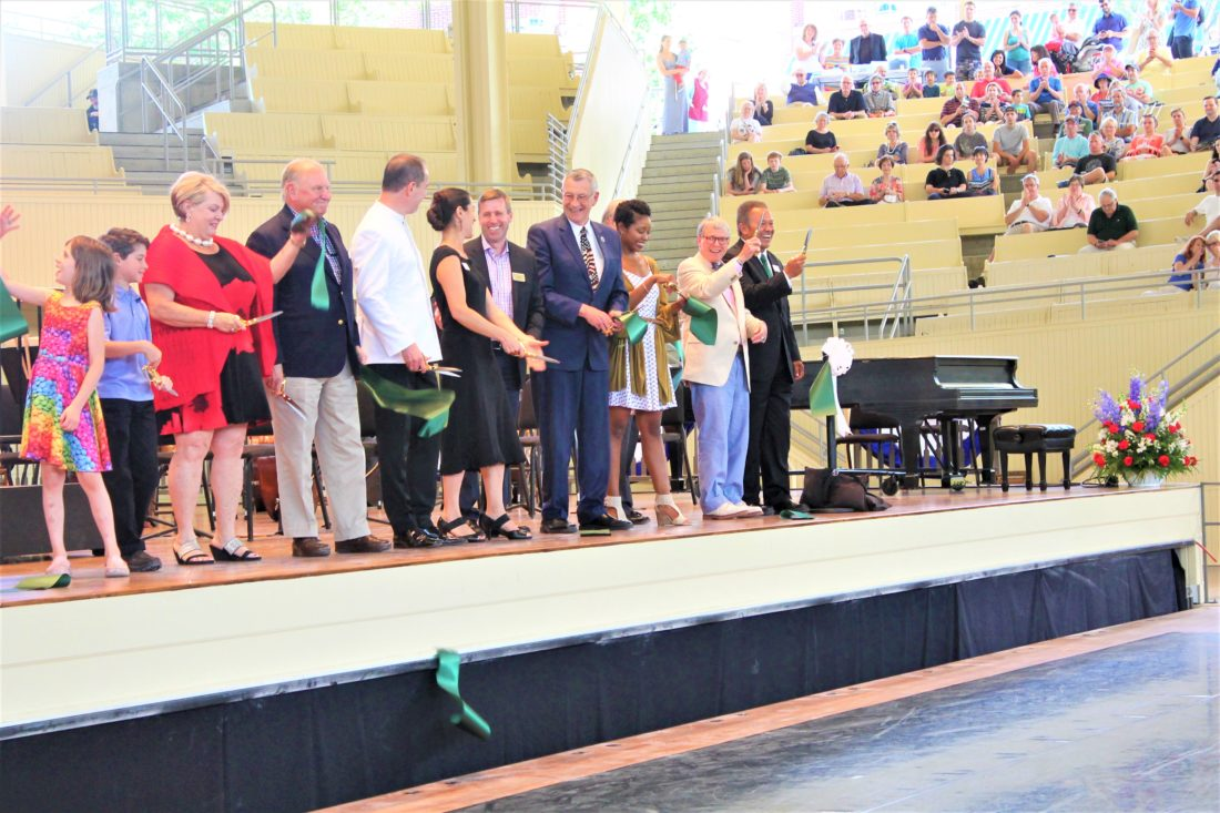Select members of the community cut the ribbon at the Chautauqua Amphitheater celebration.